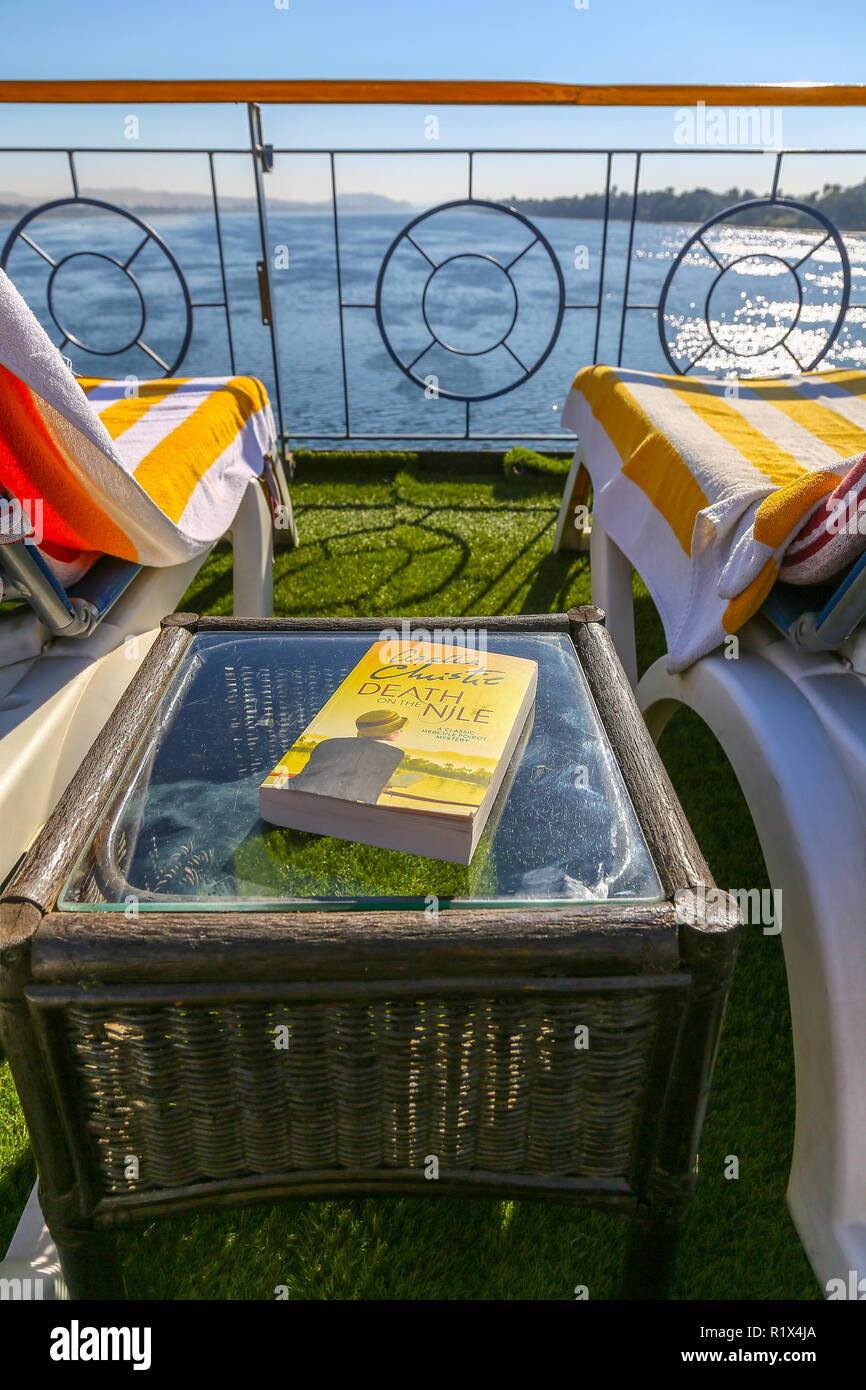 A copy of Agatha Christie's paperback book 'Death on the Nile' on the deck of a River Nile cruise ship, Aswan, Egypt, Africa - Stock Image