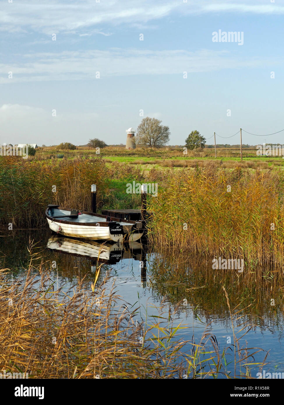 Boats moored in the narrow cut of West Somerton staithe, a remote part of the Norfolk Broads accessed via the River Thurne and Martham Broad. Stock Photo