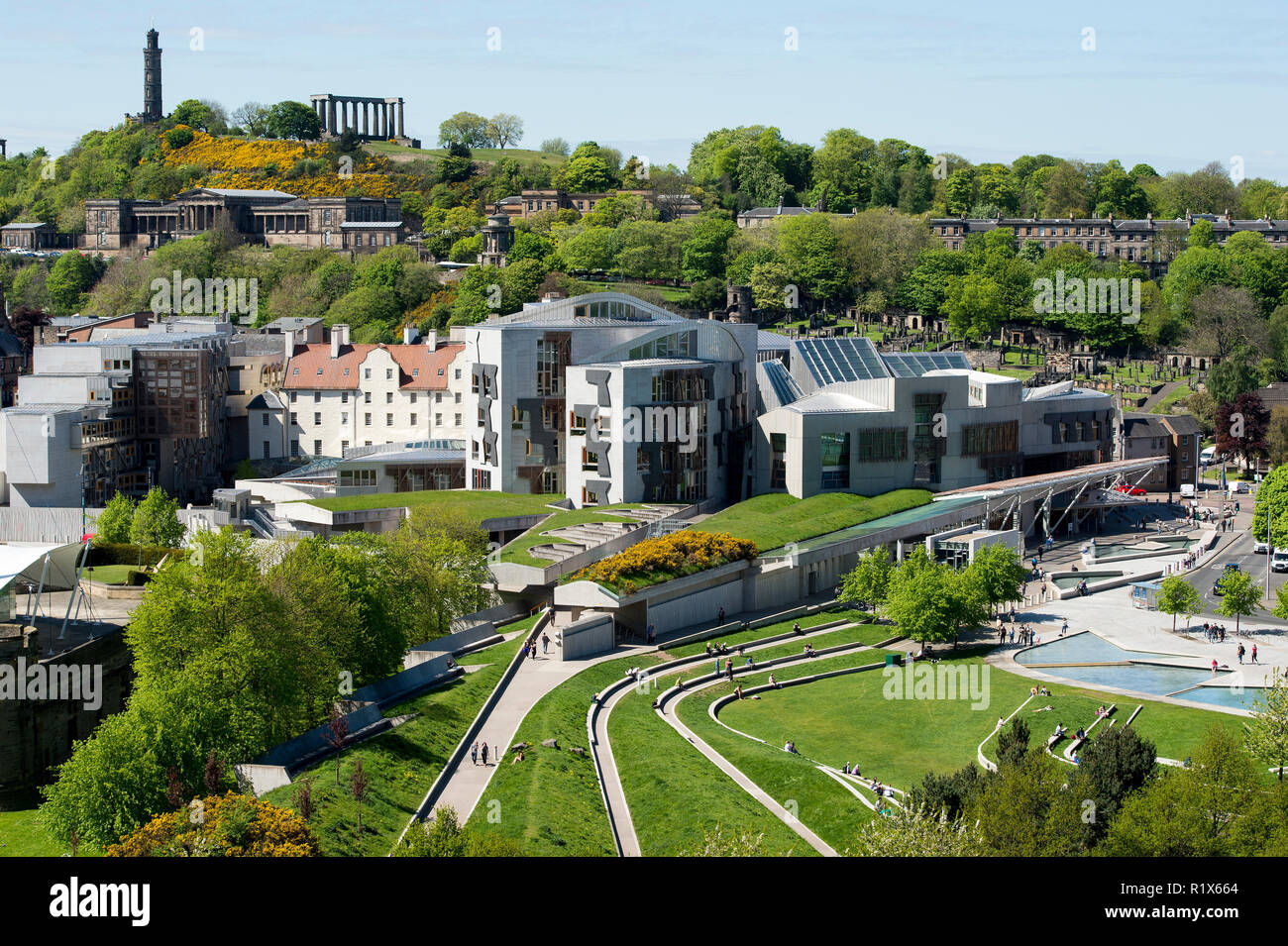 A view of the Scottish Parliament at Holyrood and Calton Hill behind, Edinburgh, Scotland. - Stock Image