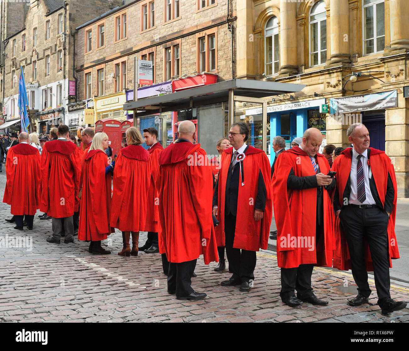 Marchers in red academic gowns on the Riding of the Marches, Edinburgh, Scotland - Stock Image