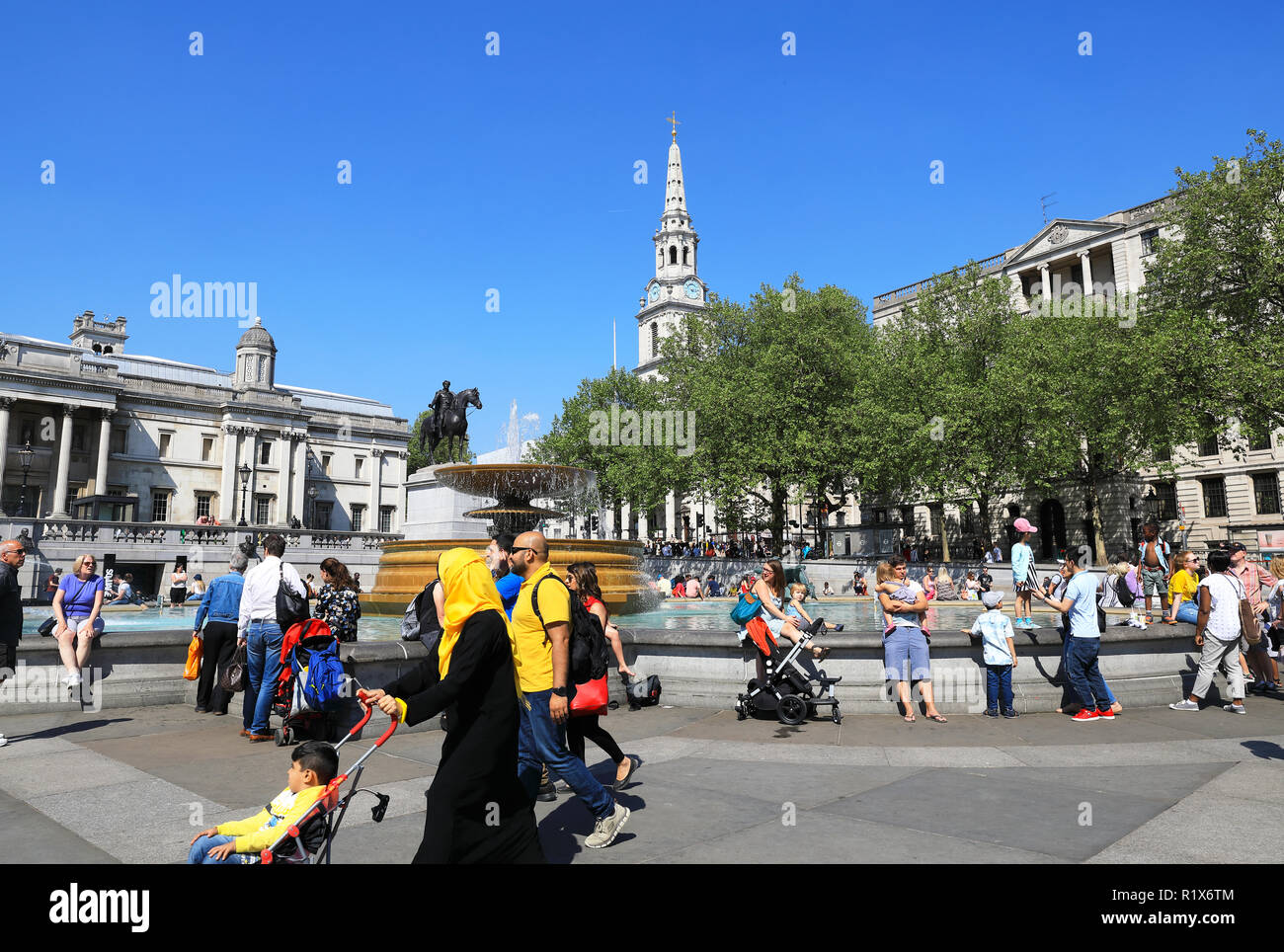 Diversity of visitors to Trafalgar Square, in central London, UK - Stock Image