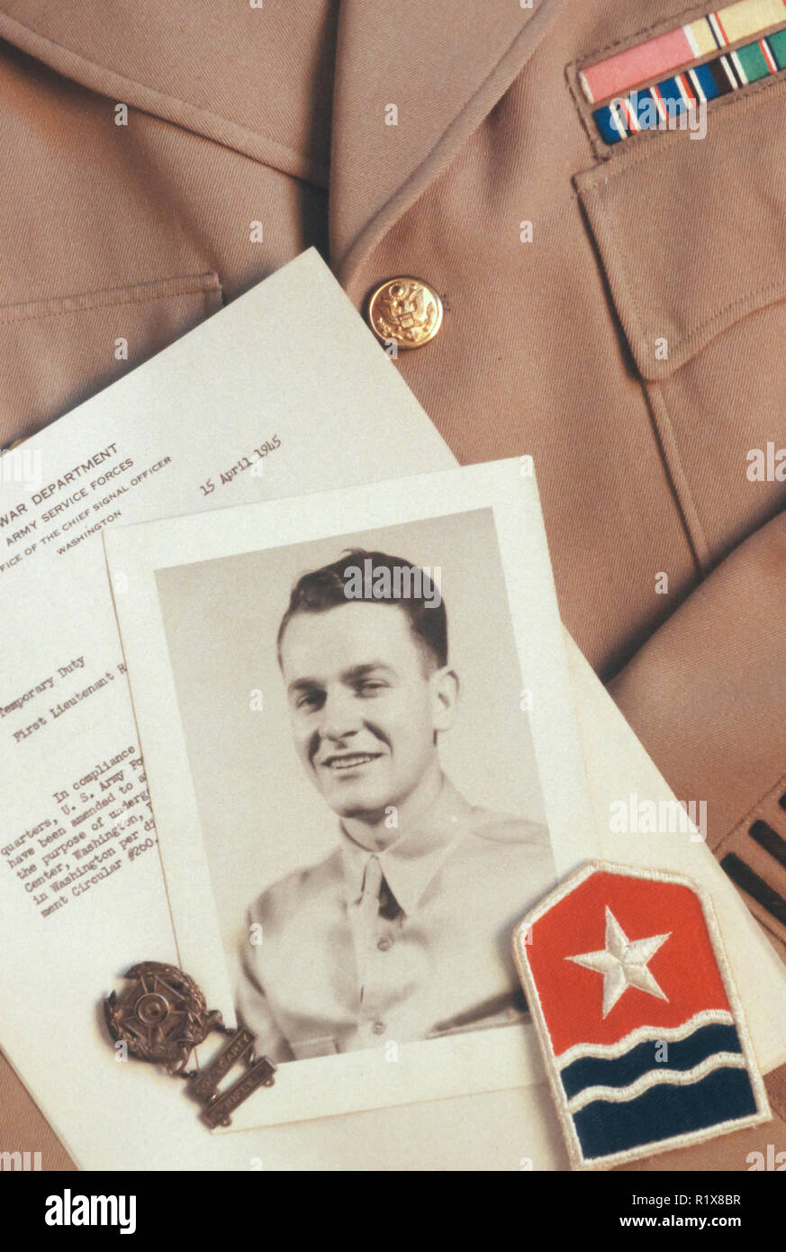 Still Life, World War 2 Photos, Badges and papers on uniform jacket, USA - Stock Image