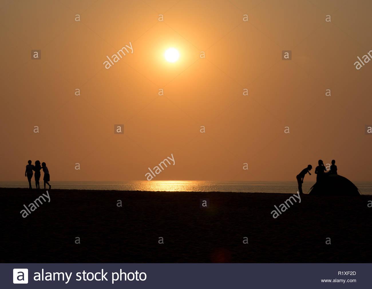 Sunset on the beach, Benguela Province, Lobito, Angola - Stock Image