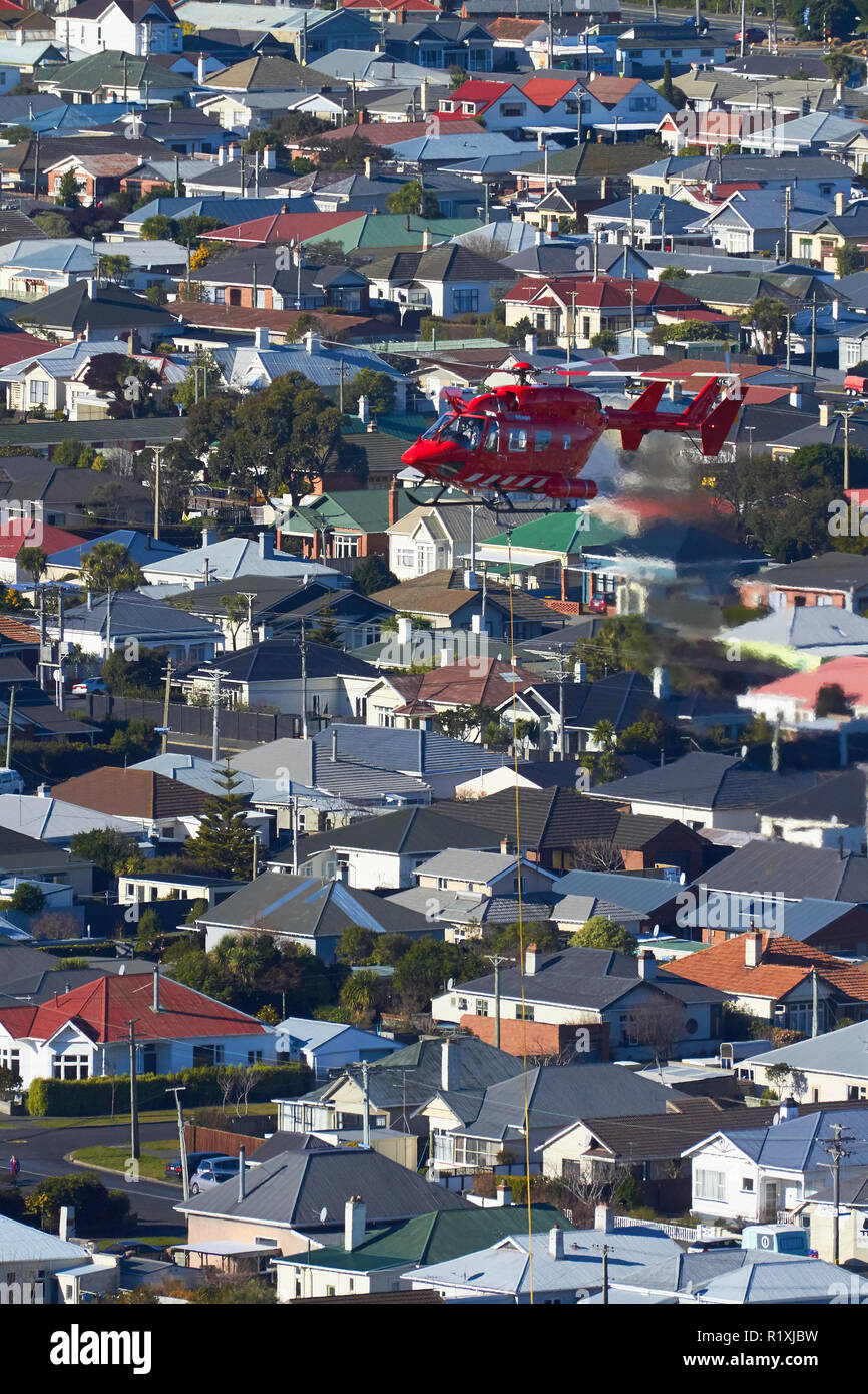 Helicopter operating over St Clair, Dunedin, South Island, New Zealand - Stock Image