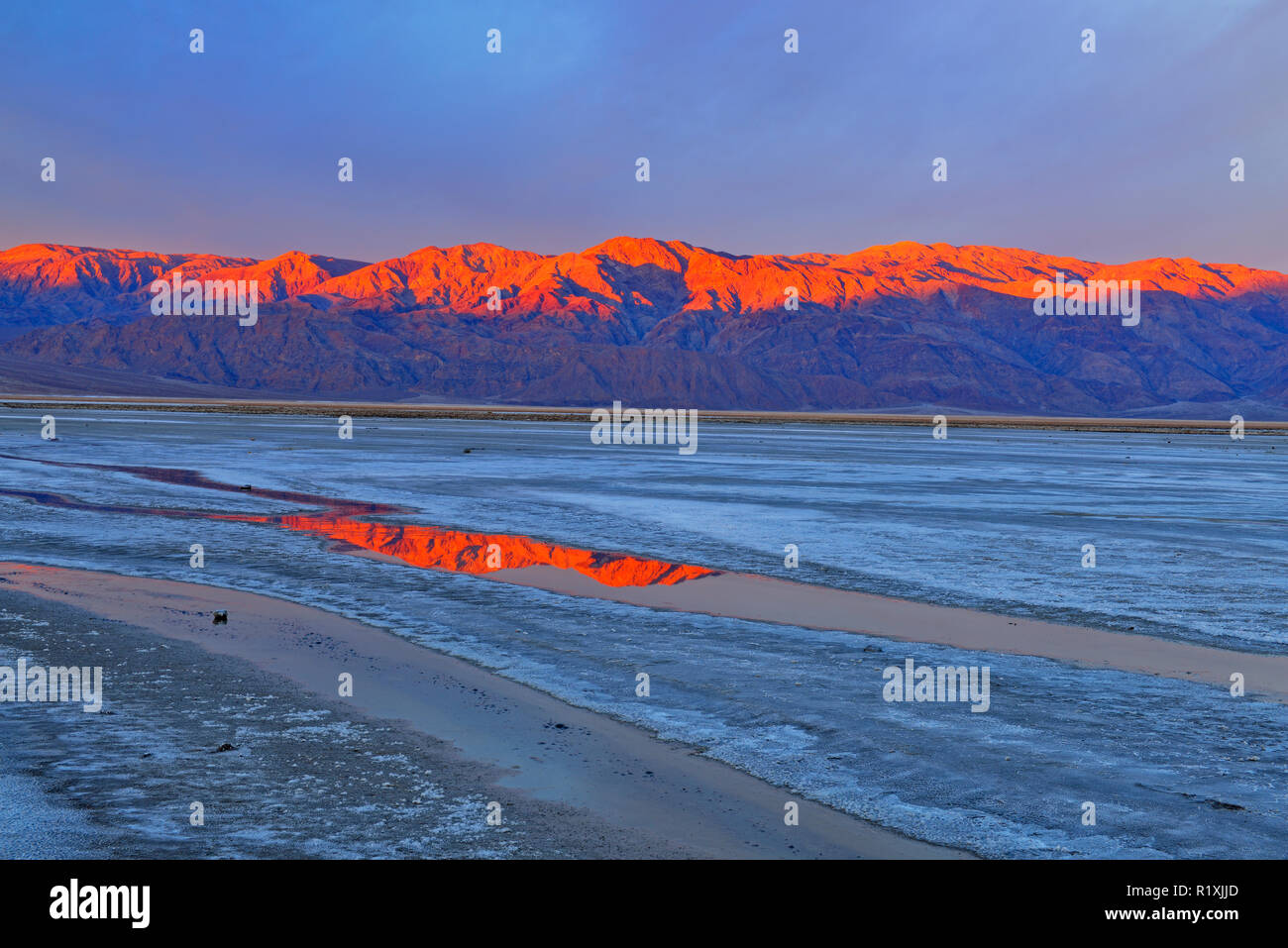 Cottonball Basin salt flats, channels and Panamint Mountains at sunrise, Death Valley National Park, California, USA Stock Photo
