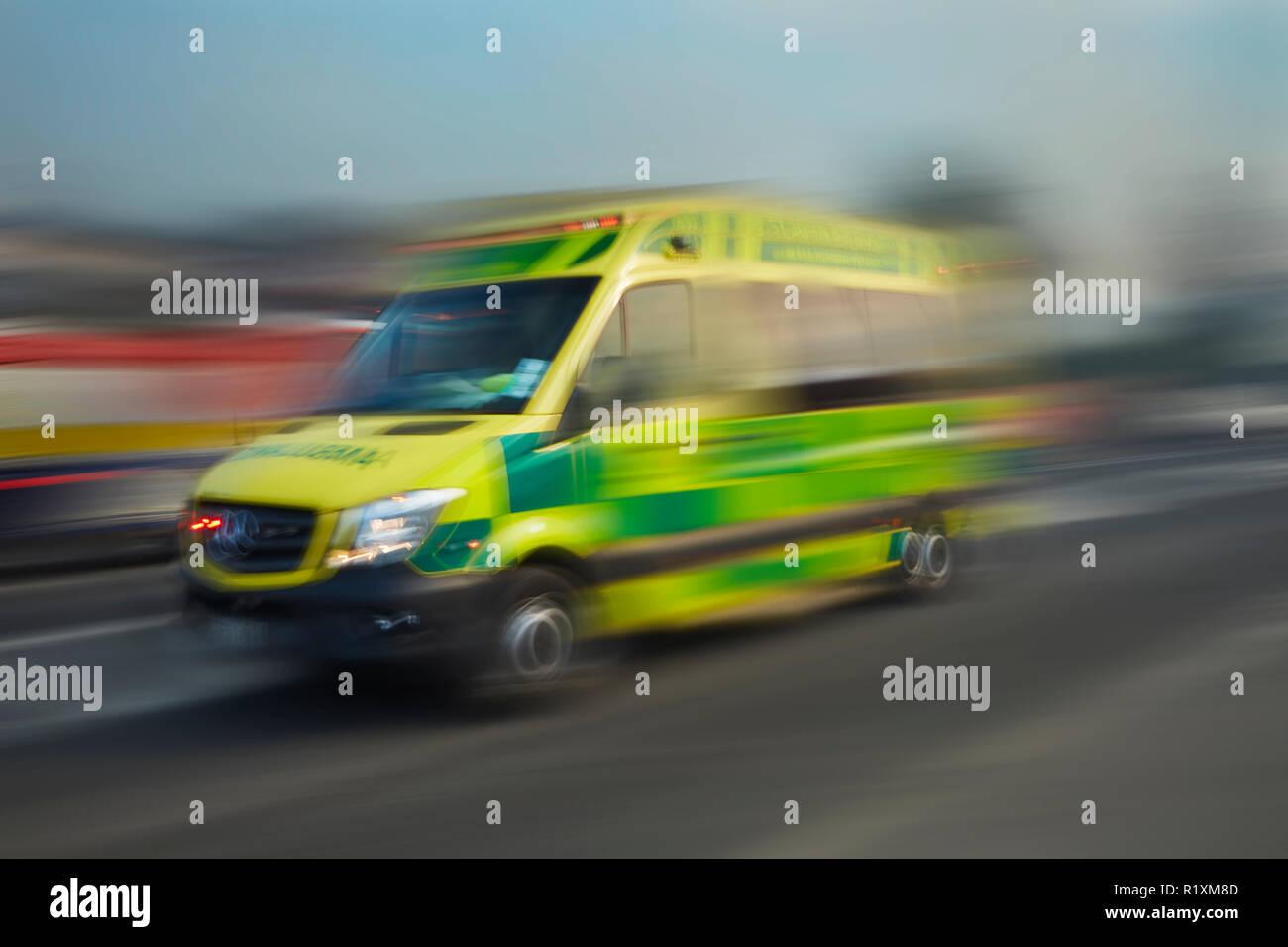 Speeding Ambulance, Dunedin, Otago, South Island, New Zealand - Stock Image