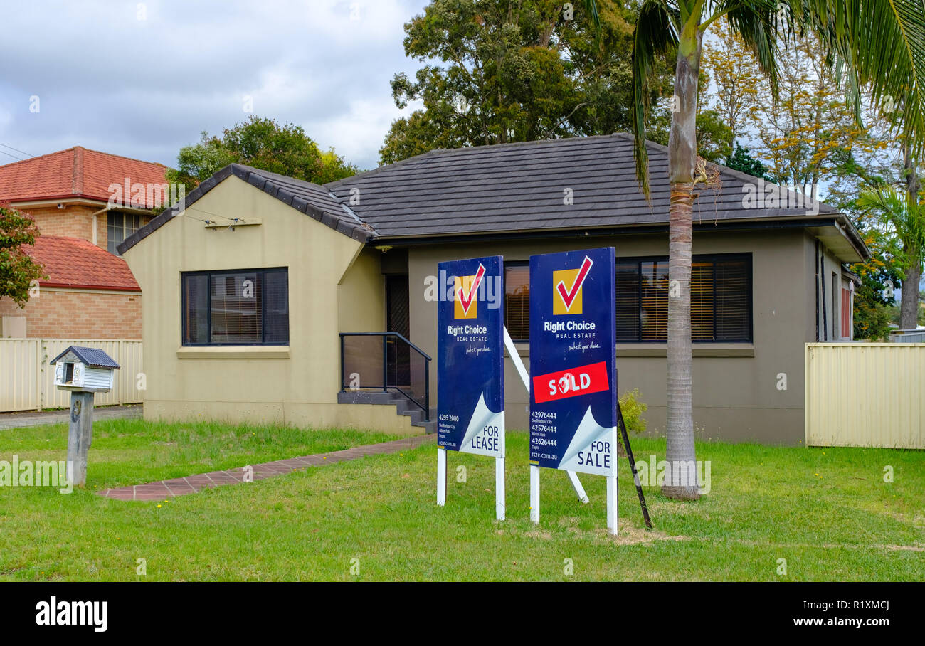 Australian For Sale and For Rent signs outside house, NSW, Australia - Stock Image
