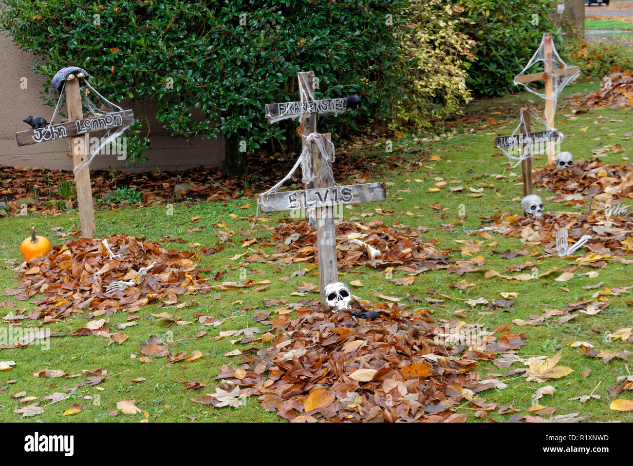 Graves And Skulls Halloween Decorations On The Front Lawn Of