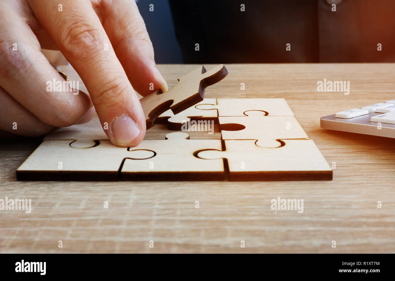 Business success and problem solving. Man holds piece of puzzle. - Stock Image