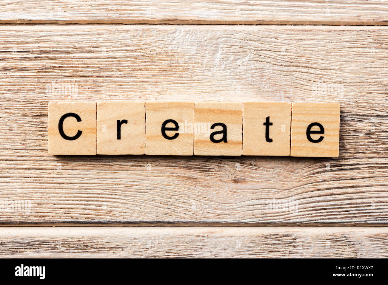 create word written on wood block. create text on table, concept. - Stock Image