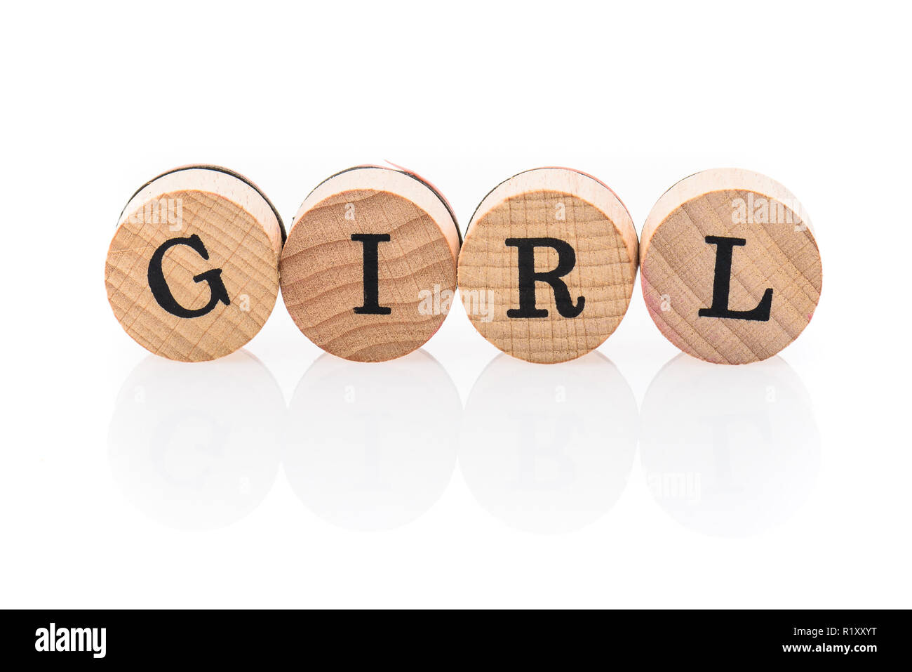 Word Girls from circular wooden tiles with letters children toy. Concept of family spelled in children toy letters. - Stock Image