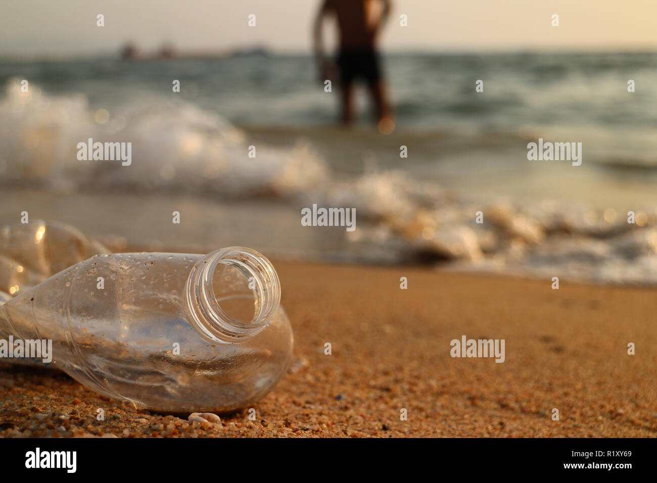 Plastic water bottle on beach - Stock Image