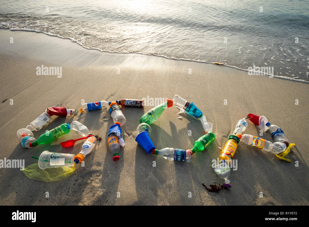 MIAMI - CIRCA AUGUST, 2018: Ocean plastic pollution awareness message spelling out STOP made from consumer drink bottles found on the beach Stock Photo