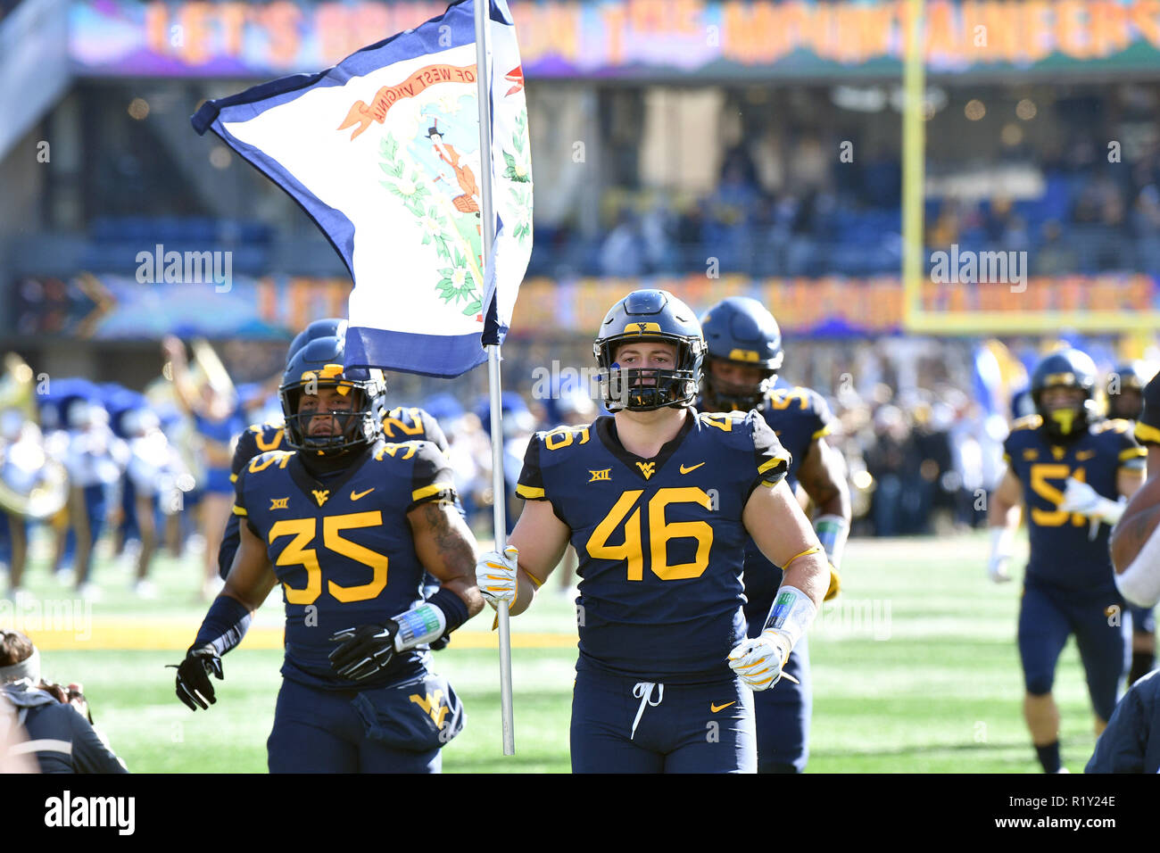 Morgantown, West Virginia, USA. 10th Nov, 2018. West Virginia Mountaineers defensive lineman REESE DONAHUE (46) carries the state flag onto the field prior to the Big 12 football game played at Mountaineer Field in Morgantown, WV. #9 WVU beat TCU 47-10 Credit: Ken Inness/ZUMA Wire/Alamy Live News - Stock Image