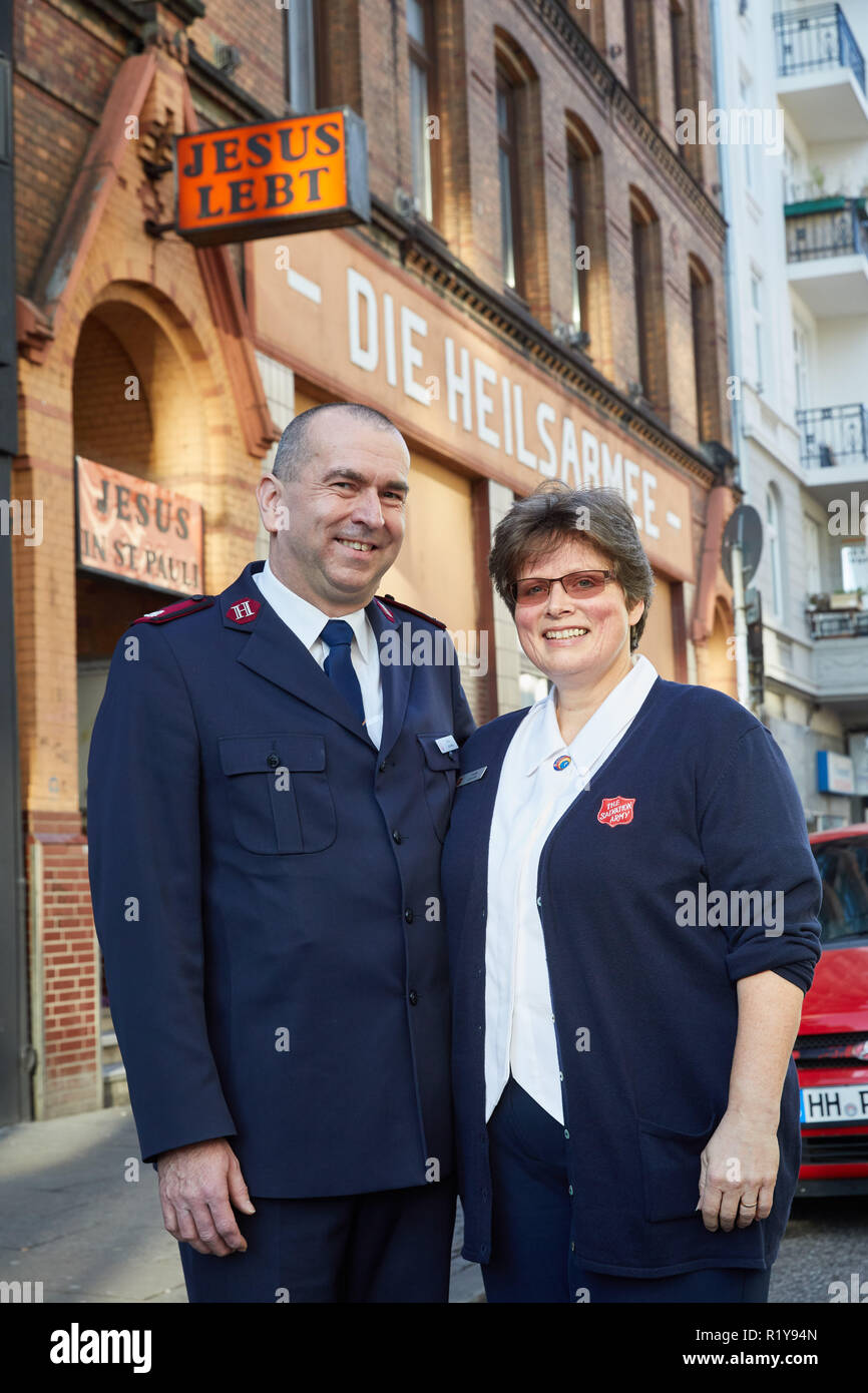 Hamburg, Germany. 15th Nov, 2018. Major Achim Janowski and his wife Major Anette Janowski, both heads of the day care center, stand in front of the Salvation Army's house on St. Pauli during a charity lunch. The building, which was captured in 1922, urgently needs to be renovated. Credit: Georg Wendt/dpa/Alamy Live News - Stock Image