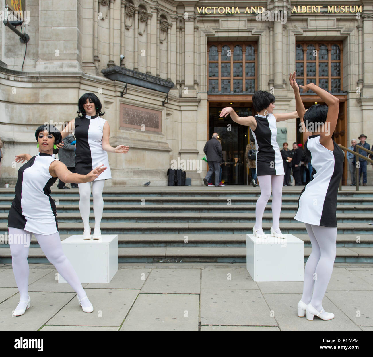 V&A, London, UK. 15 November, 2018. Meyer Dancers give a 60s Go-Go dance performance at the V&A entrance. The event marks the first time the public are able to purchase tickets for the Mary Quant exhibition opening at the V&A in 6 April 2019. Credit: Malcolm Park/Alamy Live News. - Stock Image