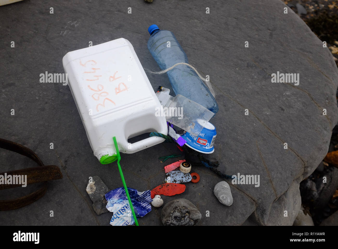 Lyme Regis UK 15th November 2018 - Plastic rubbish and ancient fossils found on the beach between Lyme Regis and Charmouth  on a grey misty afternoon along the Jurassic coast in Dorset Credit: Simon Dack/Alamy Live News - Stock Image