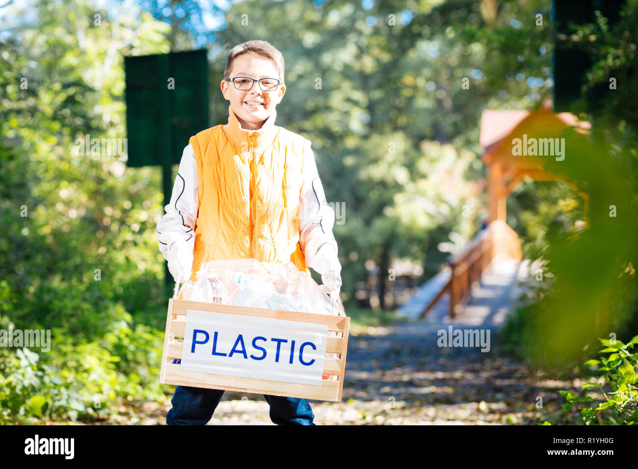 Cute cheerful nice boy smiling to you - Stock Image