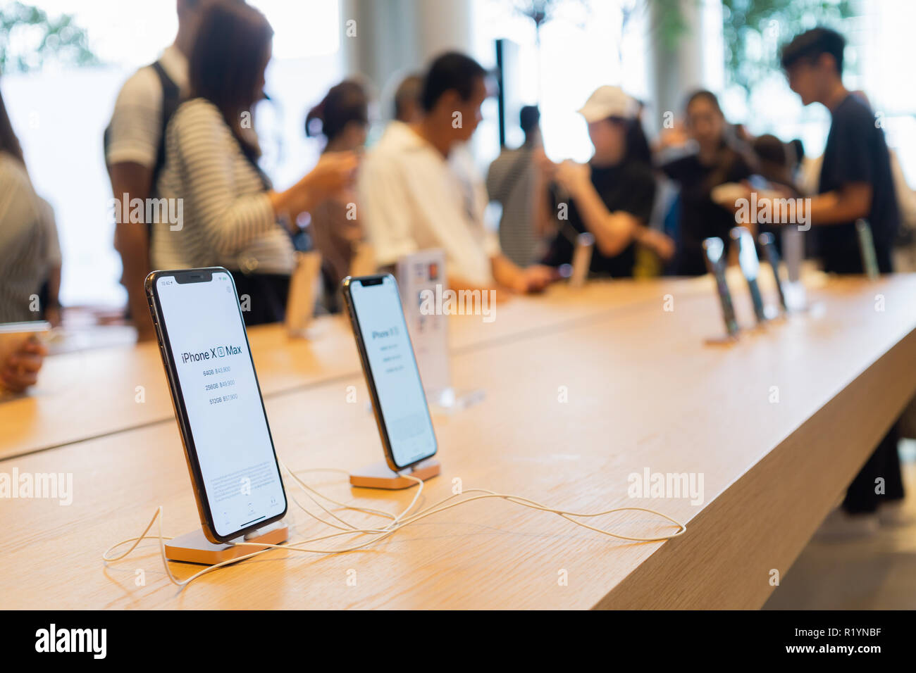 BANGKOK, THAILAND - November 11, 2018:   New iPhone XS Max charging in docking station goes on sale in Apple Store at Iconsiam Bangkok Thailand. - Stock Image