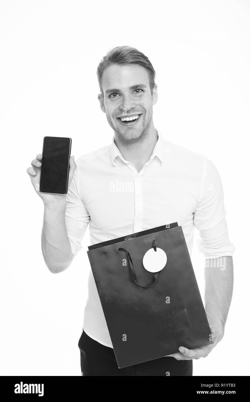 Hard earned cash and precious time you are spendings worth few minutes of preparation. Shopping online save time. Guy with smartphone and shopping bag happy purchase online. Shopping application. - Stock Image