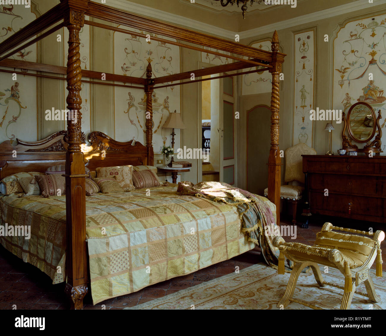 Antique bed in Tuscan bedroom with vintage murals on walls Stock ...