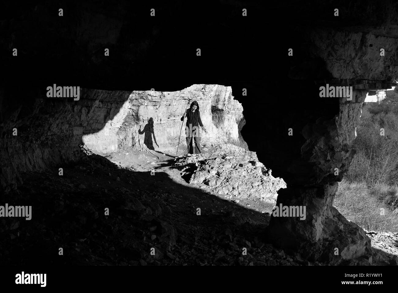Exploring 'Canaraua Fetei' amazing grotto in a special protection area at the border with Bulgaria, in Dobrogea land, Romania. Black and white image. - Stock Image