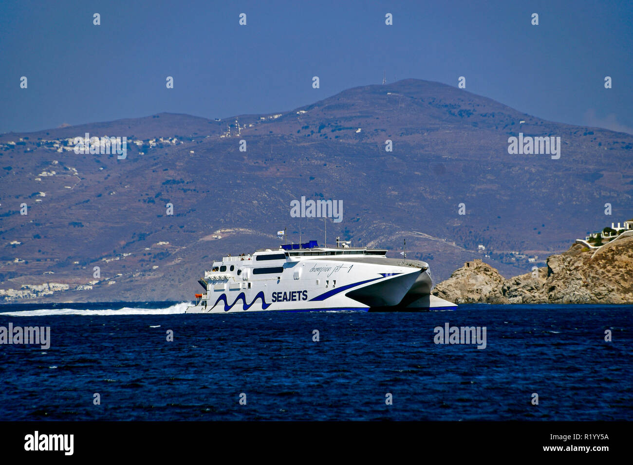 Seajets catemaran Champion Jet 1 near Mykonos town on island Mykonos in the Cyclades group in the Aegean Sea Greece - Stock Image