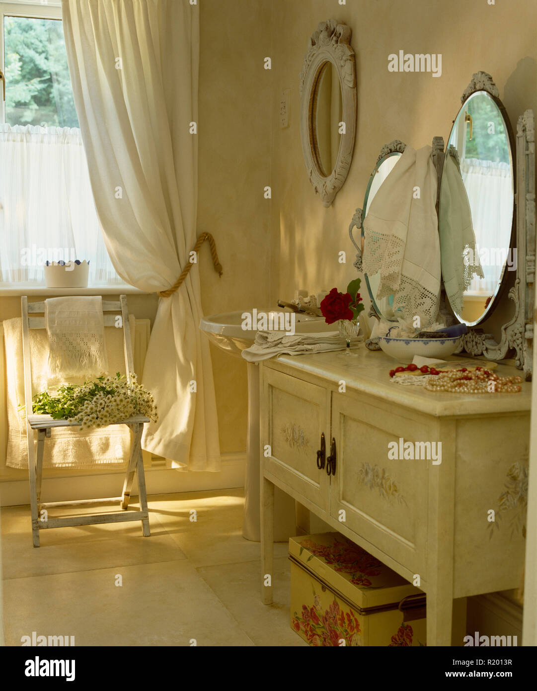 Oval Mirror On Cream Painted Dressing Table Stock Photo Alamy