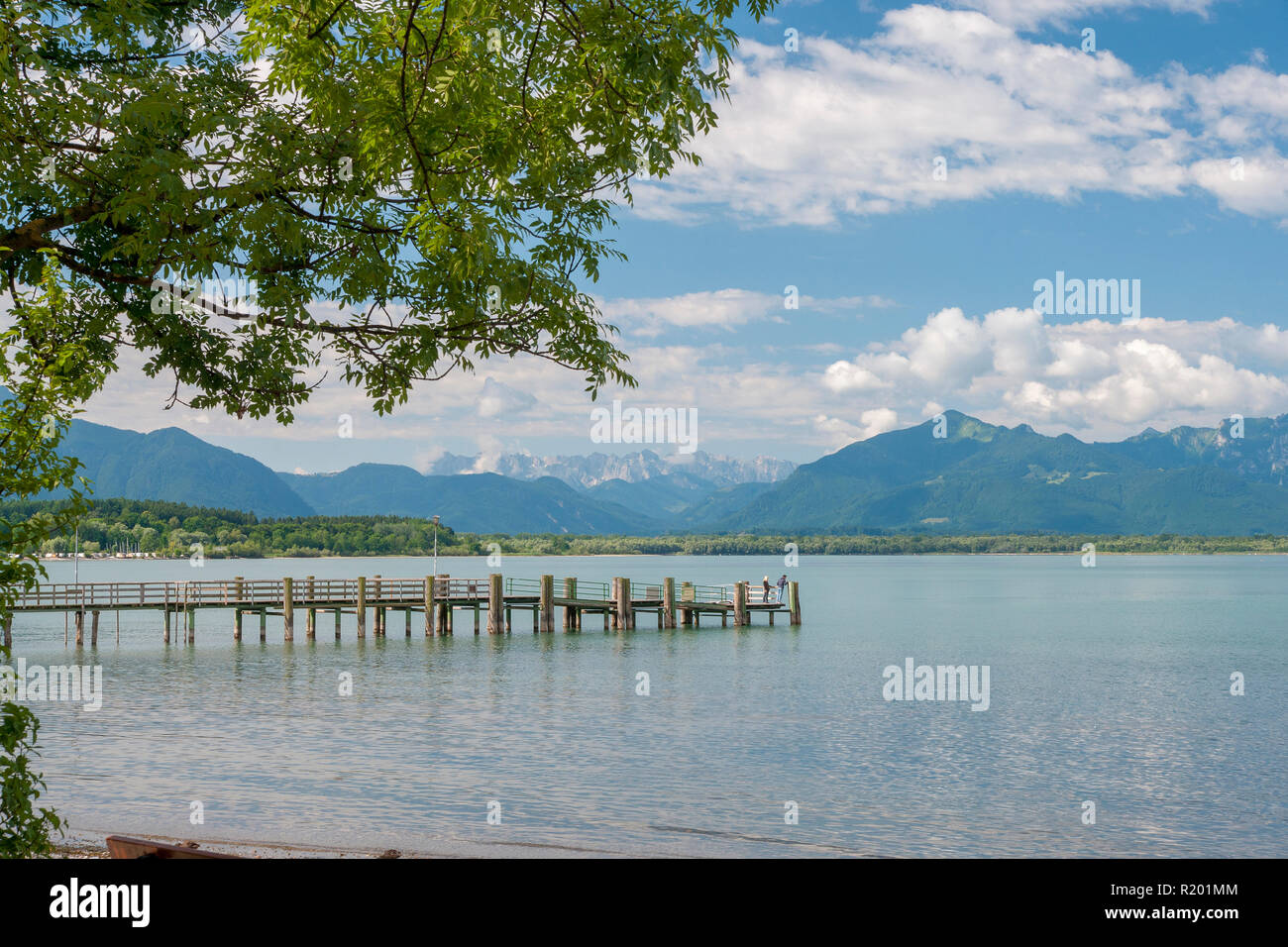 Lake Chiemsee: Jetty at the village Chieming with the Alps in background. Bavaria, Germany Stock Photo