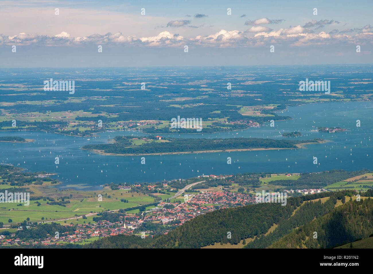 Lake Chiemsee with Herreninsel, Krautinsel und Fraueninsel seen from the mountain Kampenwand. Bavaria, Germany - Stock Image