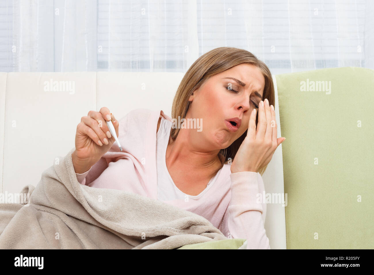 Woman coughing - Stock Image