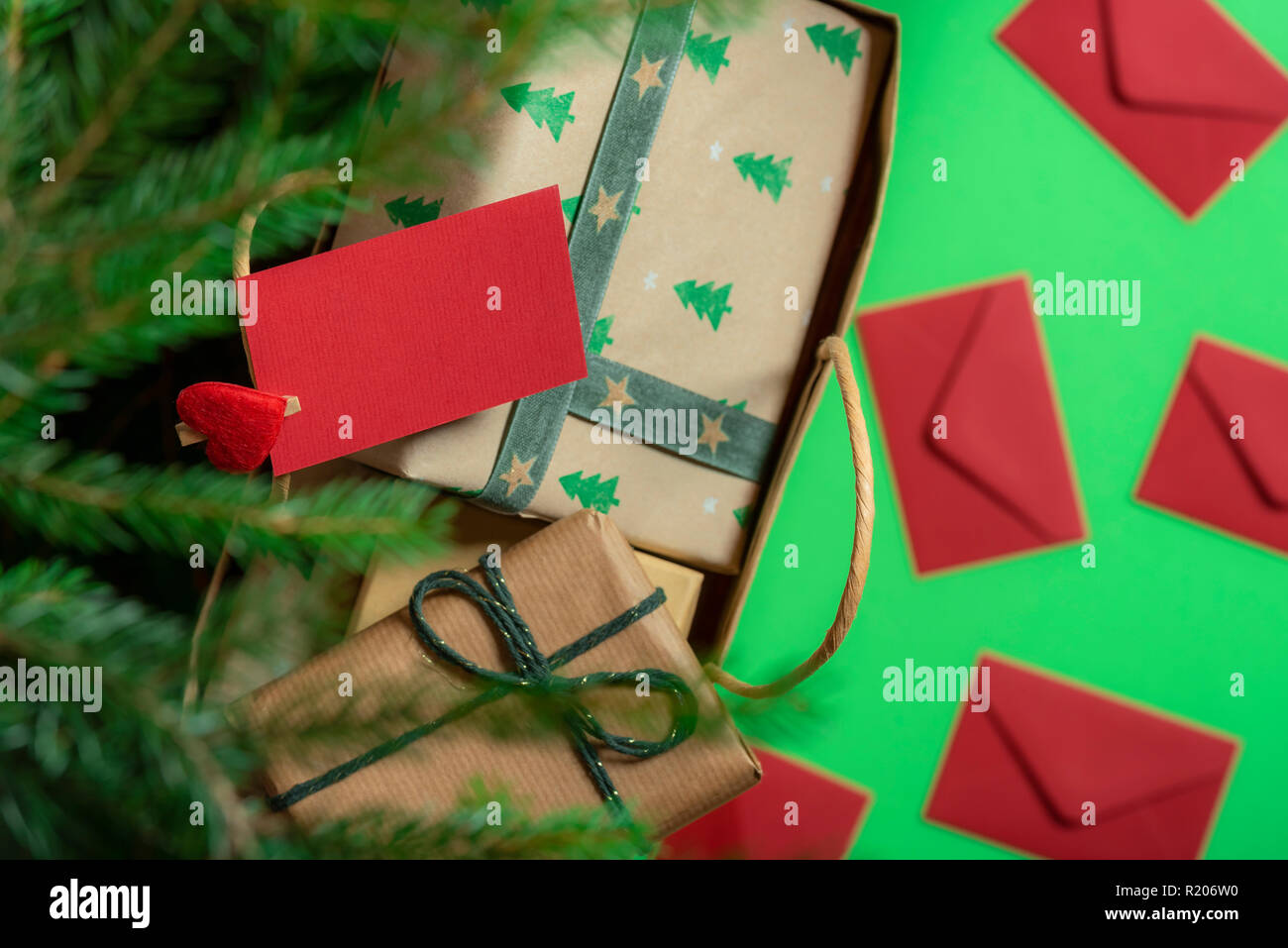 top view of a paper bag full with gift boxes under a christmas tree