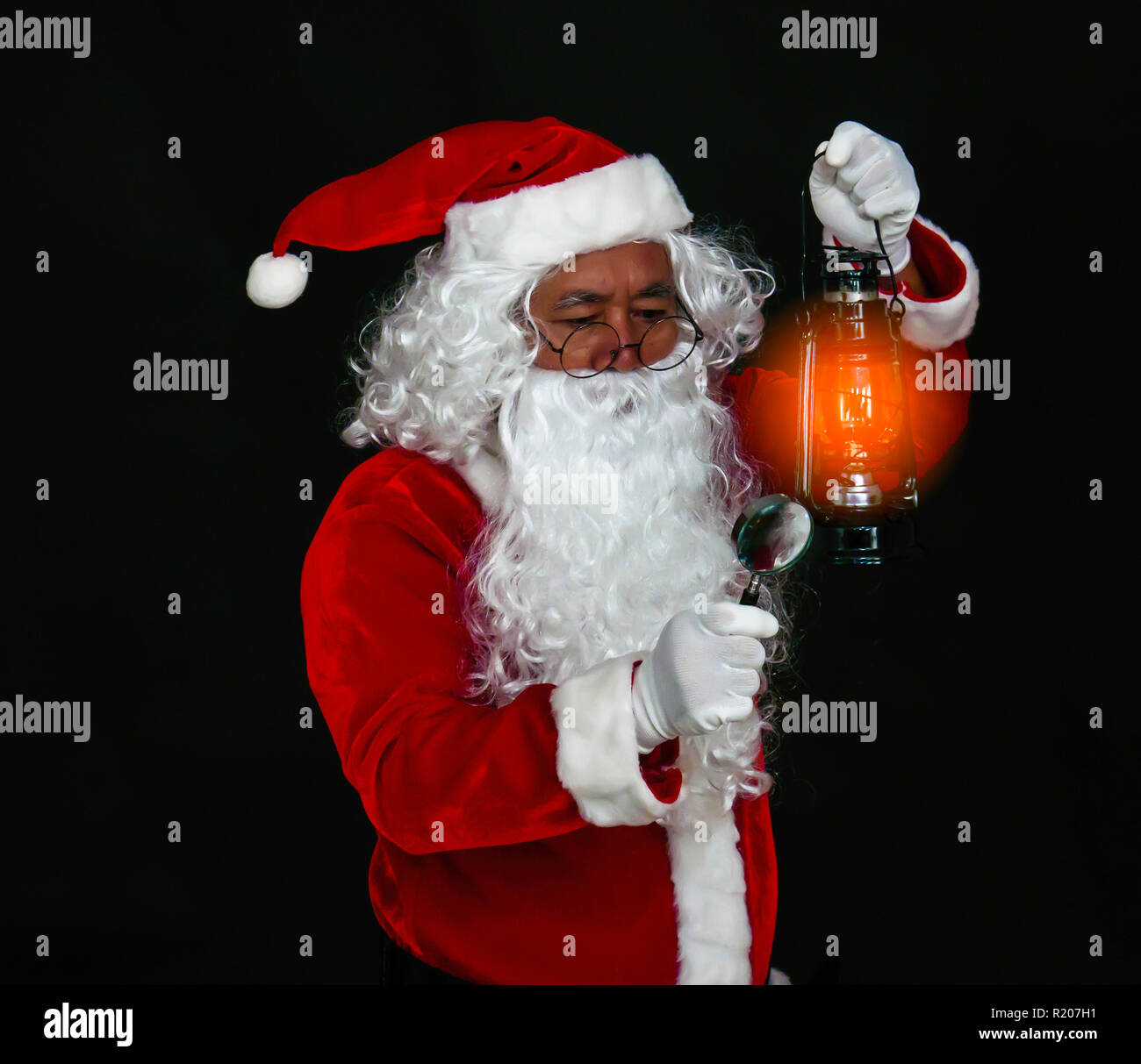 aa8f44fbc6150 Santa Claus holding lantern for lighting studio shot on black background  for family