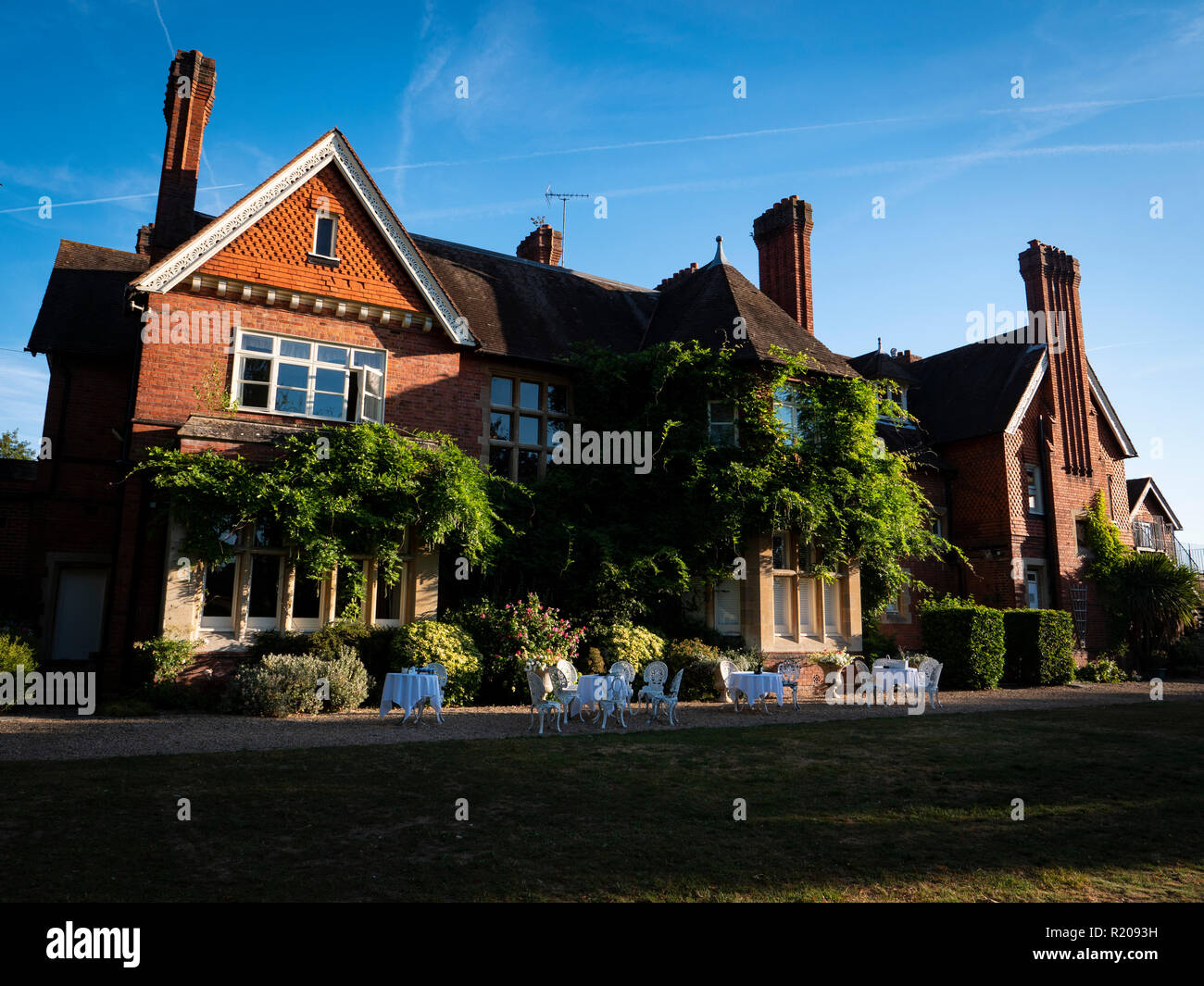 Red Brick Exterior 19th century Victorian Country House. Hotel in early morning sun light Berkshire UK. Stock Photo