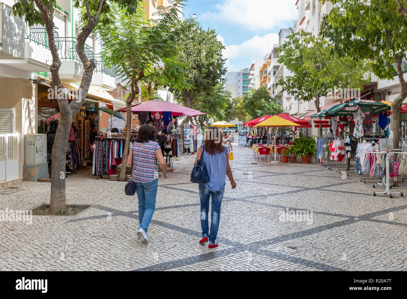 Pedestrian precinct in Monte Gordo town centre with shops and cafes, Algarve, Portugal - Stock Image