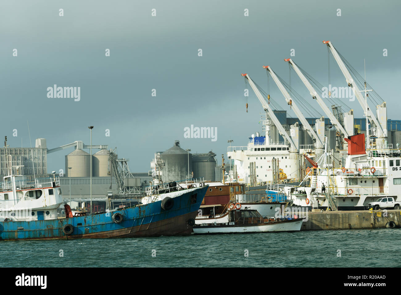 Durban, KwaZulu-Natal, South Africa, collection of seagoing ships tied to moorings dockside in harbour - Stock Image