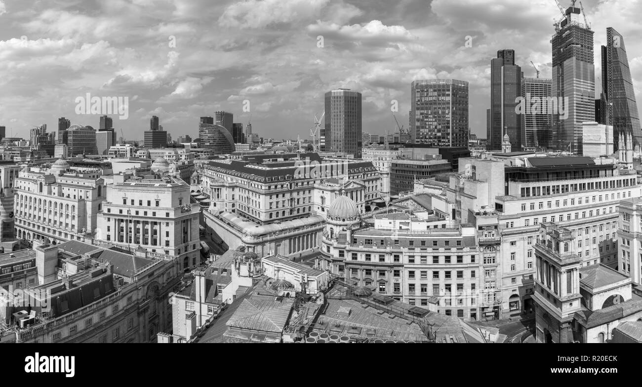 Rooftop skyline view of the Bank of England, Threadneedle Street, and City of London financial district, EC2 with iconic modern skyscrapers behind - Stock Image
