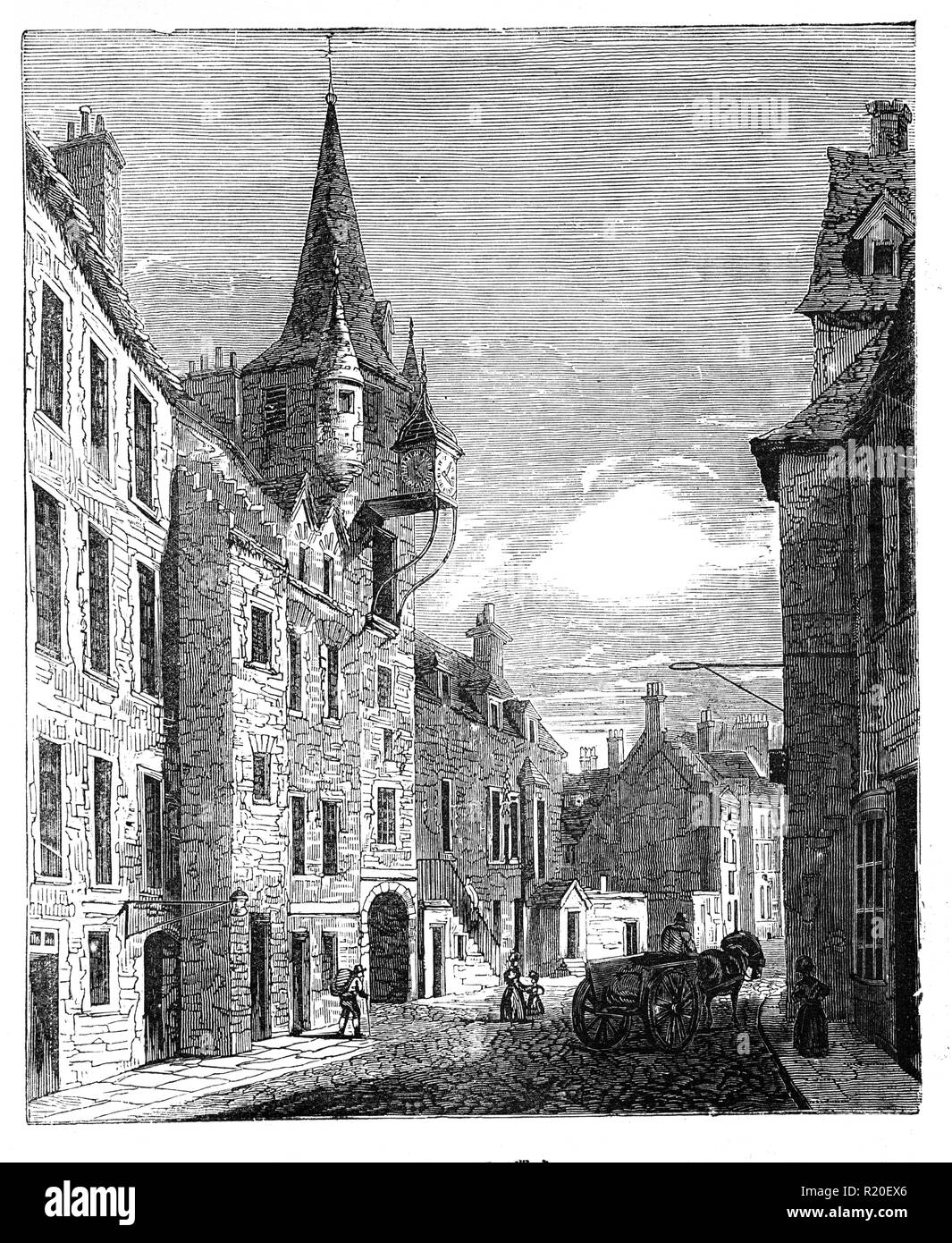 The Canongate Tolbooth was built in 1591 and would have formed the local hub for the Canongate burgh, along with the nearby Mercat Cross where merchants met and conducted their business. The Tolbooth would have had many functions, serving as courthouse, burgh jail and meeting place of the town council. The building was constructed for Sir Lewis Bellenden, the justice-clerk for the burgh, and his initials can still be seen over the archway to Tolbooth Wynd. Edinburgh, Scotland - Stock Image