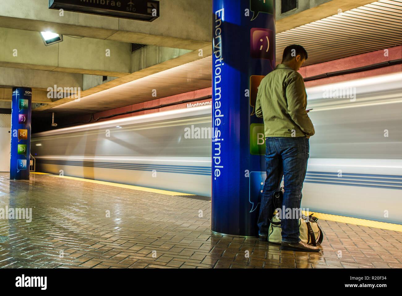 San Francisco, CA / USA - 5/1/2015: Man Waiting For Bart Alone - Stock Image