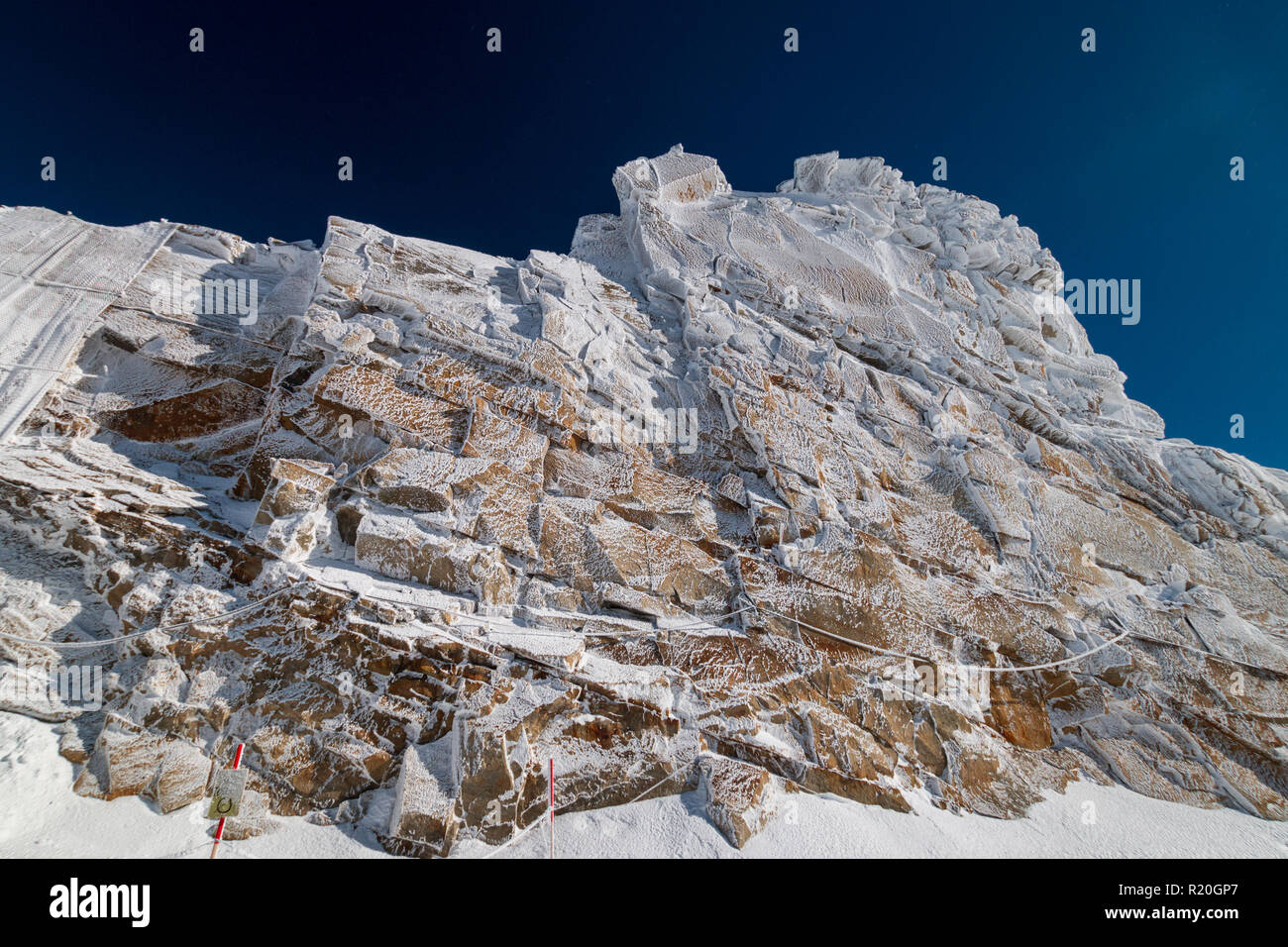 "So called ""frozen wall"" in front of a blue sky in Austrian ski region of Hintertux Glacier, Zillertal, Austria Stock Photo"