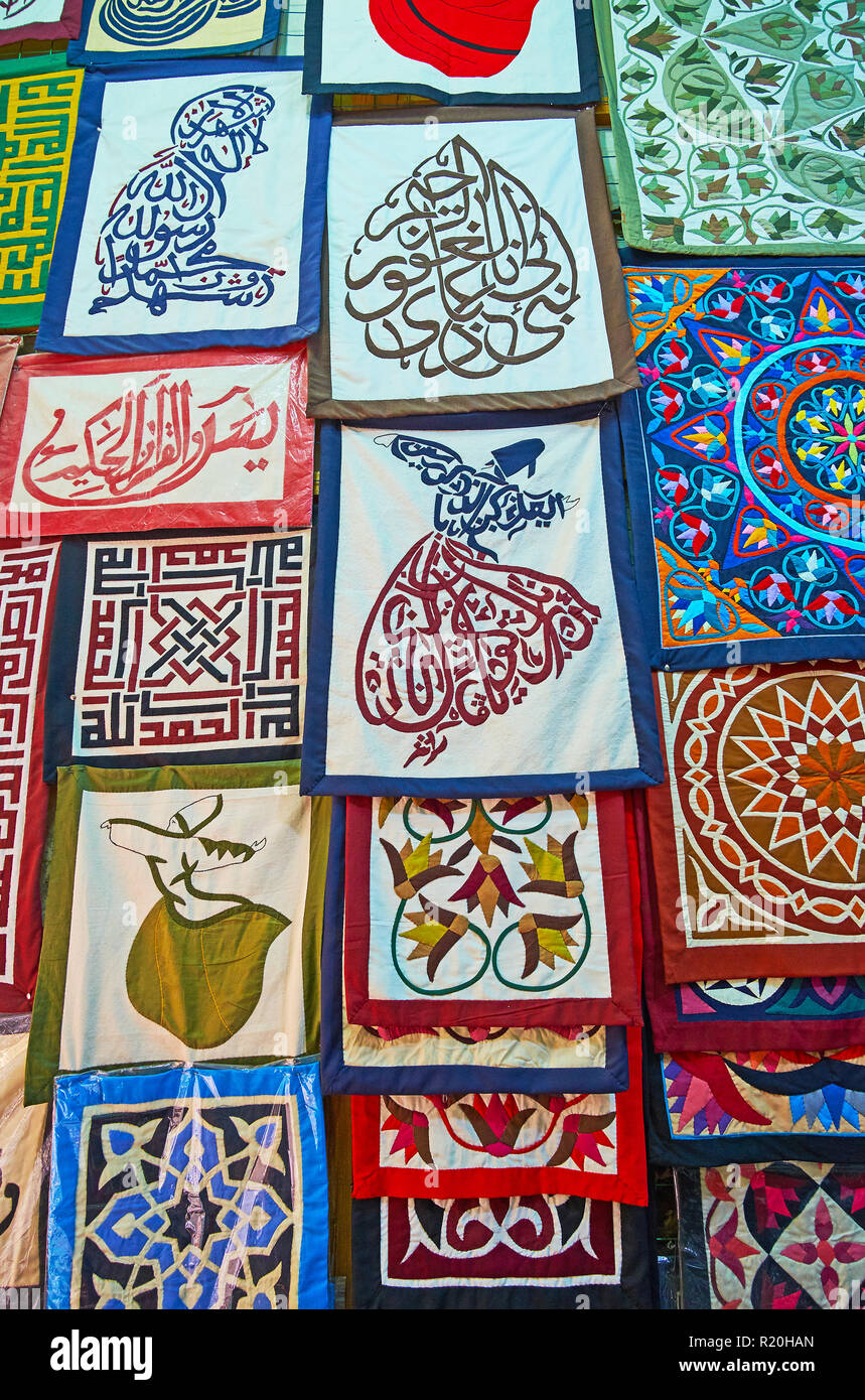 Collection of handmade pillowcases with colorful appliques, embroideries and Islamic calligraphy in shapes of dancing dervish, praying man or geometri - Stock Image