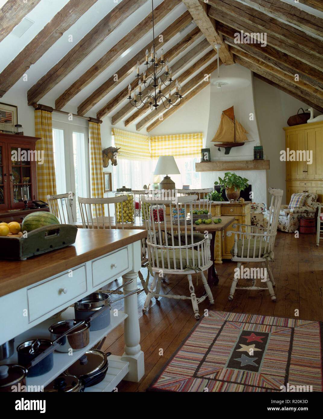 Painted stick back chairs in farmhouse kitchen Stock Photo