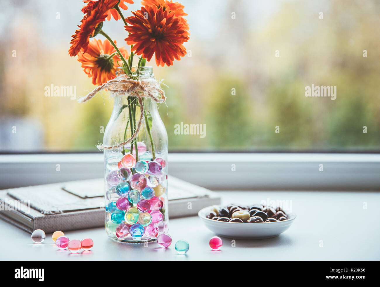 Water crystal gel or water beads is any gel which contains a large amount of water. Different color fun jelly water balls in flower vase in kitchen. Stock Photo