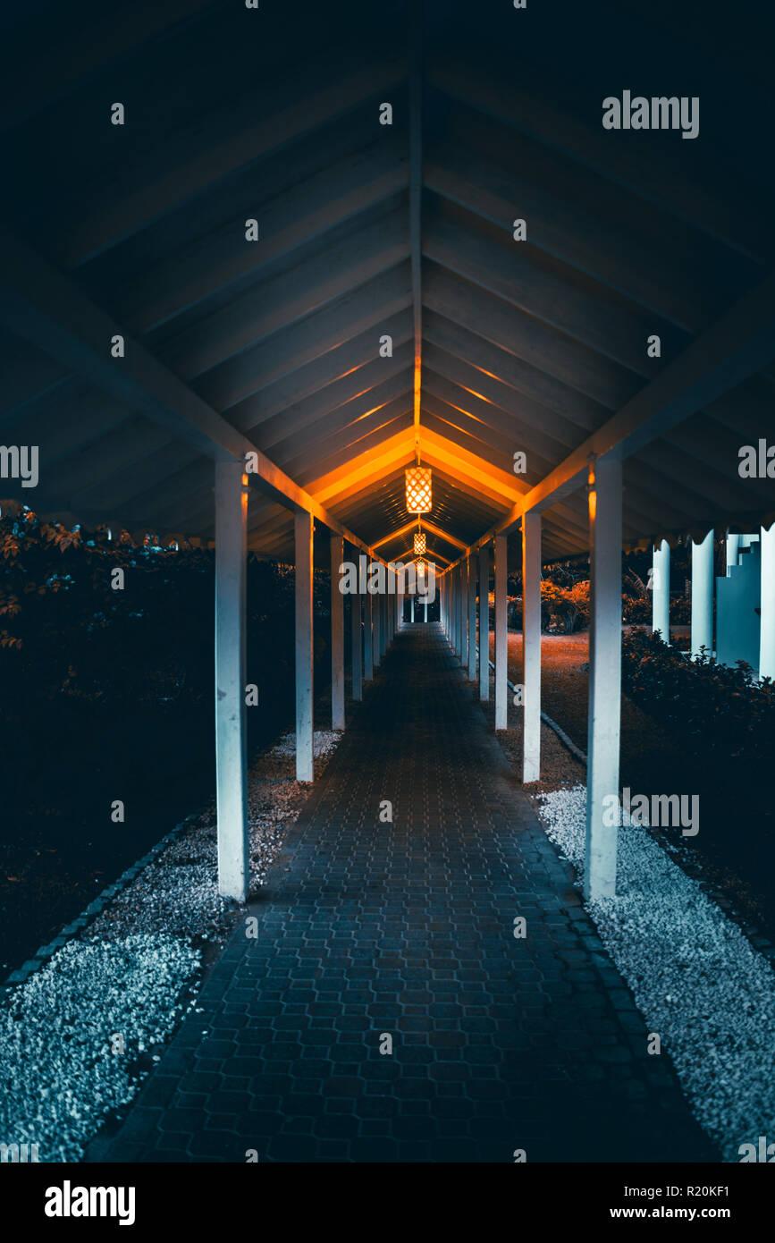Looking down orange lit pathway - Stock Image