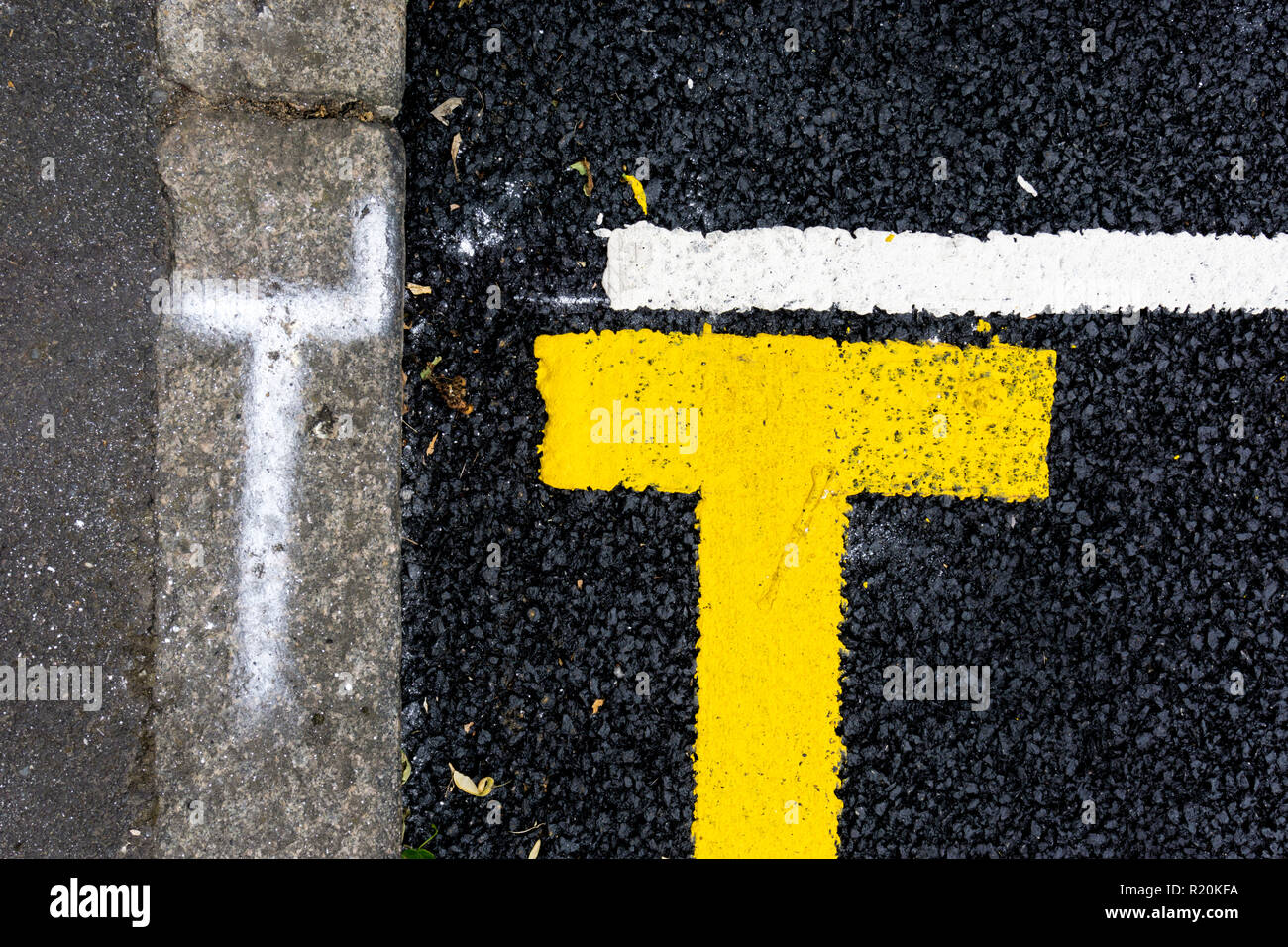New road markings.  Yellow line and parking bay. - Stock Image
