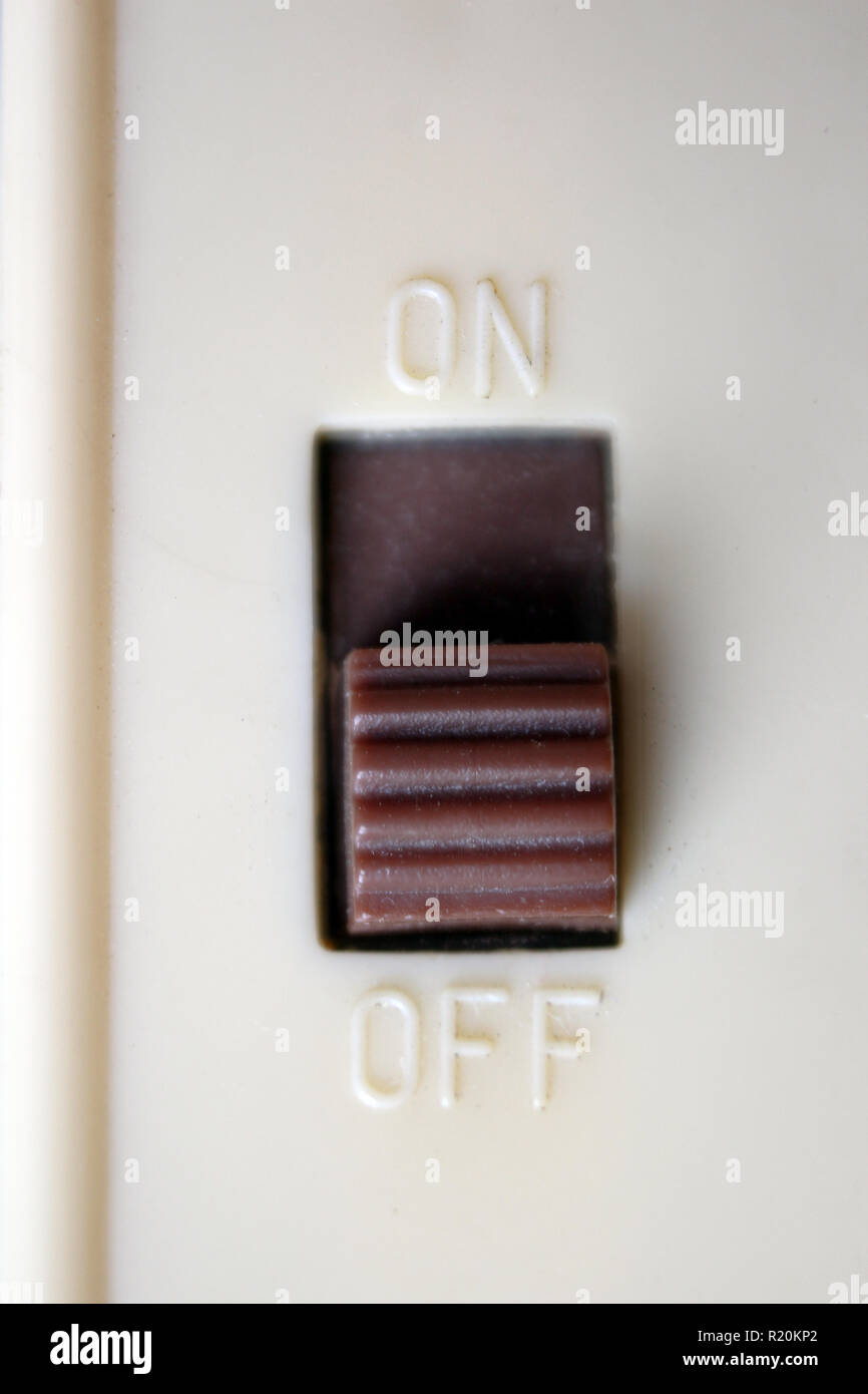 Plastic switch on and off, close-up - Stock Image