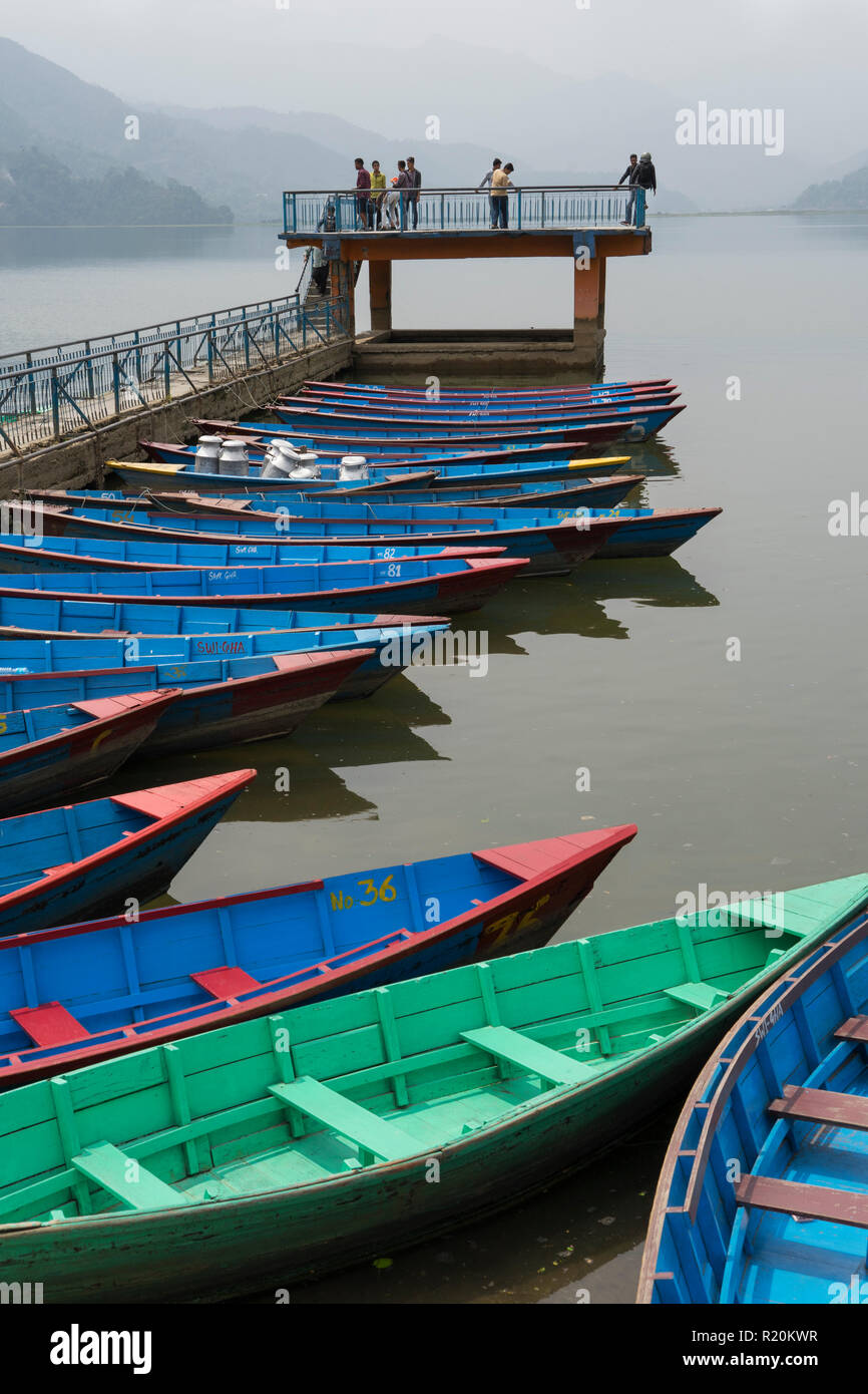 Colourful rowboats for hire, Phewa Lake, Pokhara, Nepal. - Stock Image