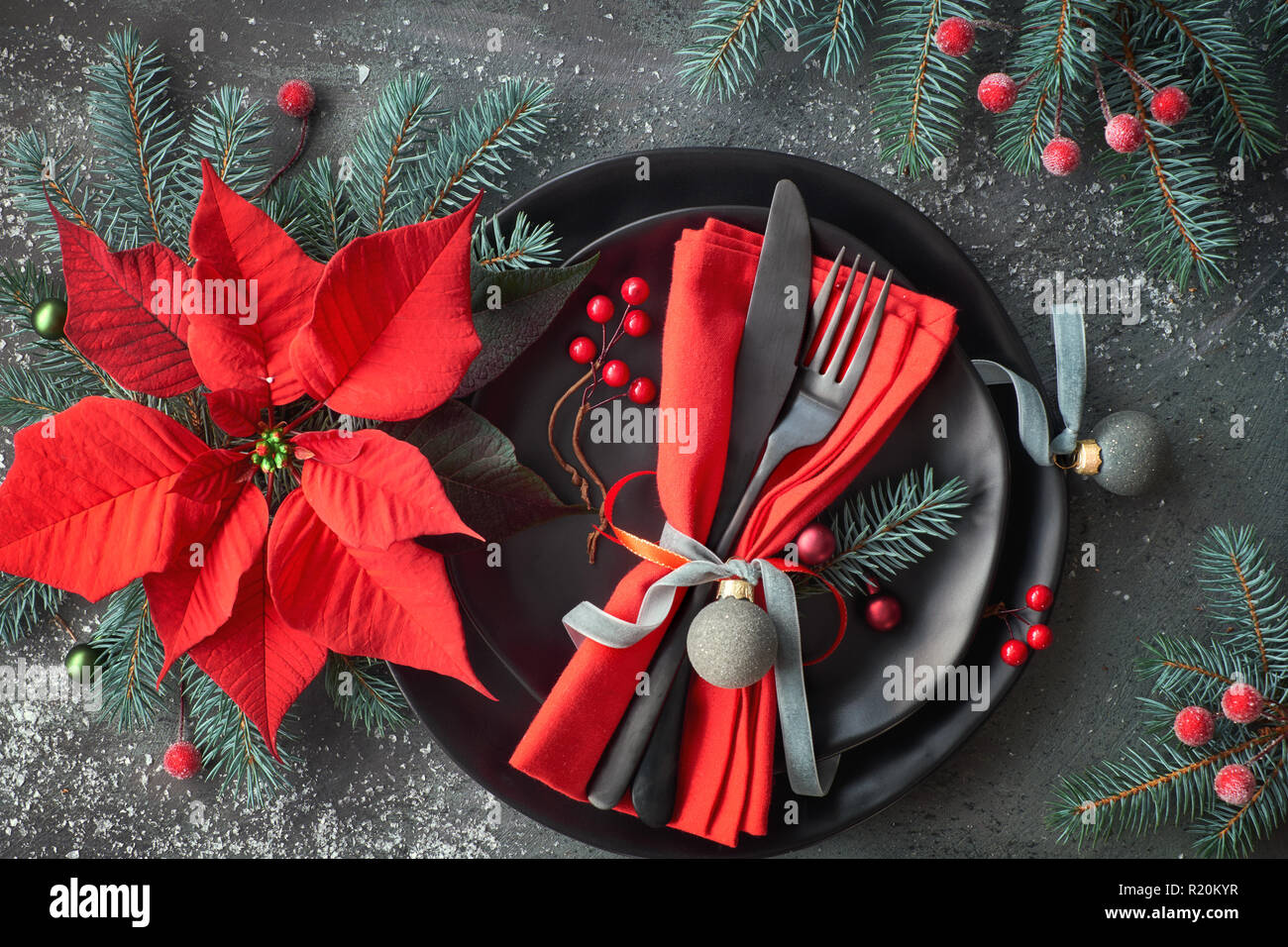 Flat Lay With Christmas Table Setting In Green And Red With Frosted Berries Trinkets Black Plates And Crockery On Dark Stock Photo Alamy