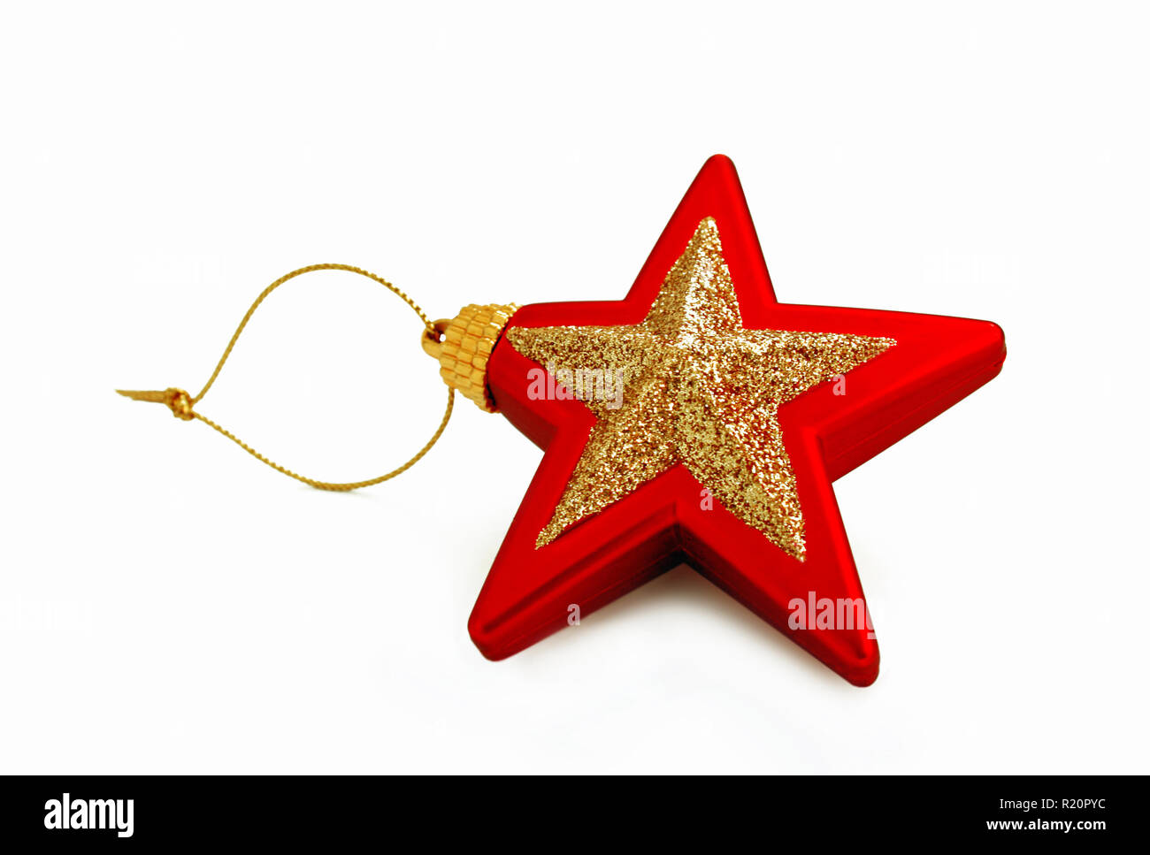 red and golden star isolated on white - Stock Image