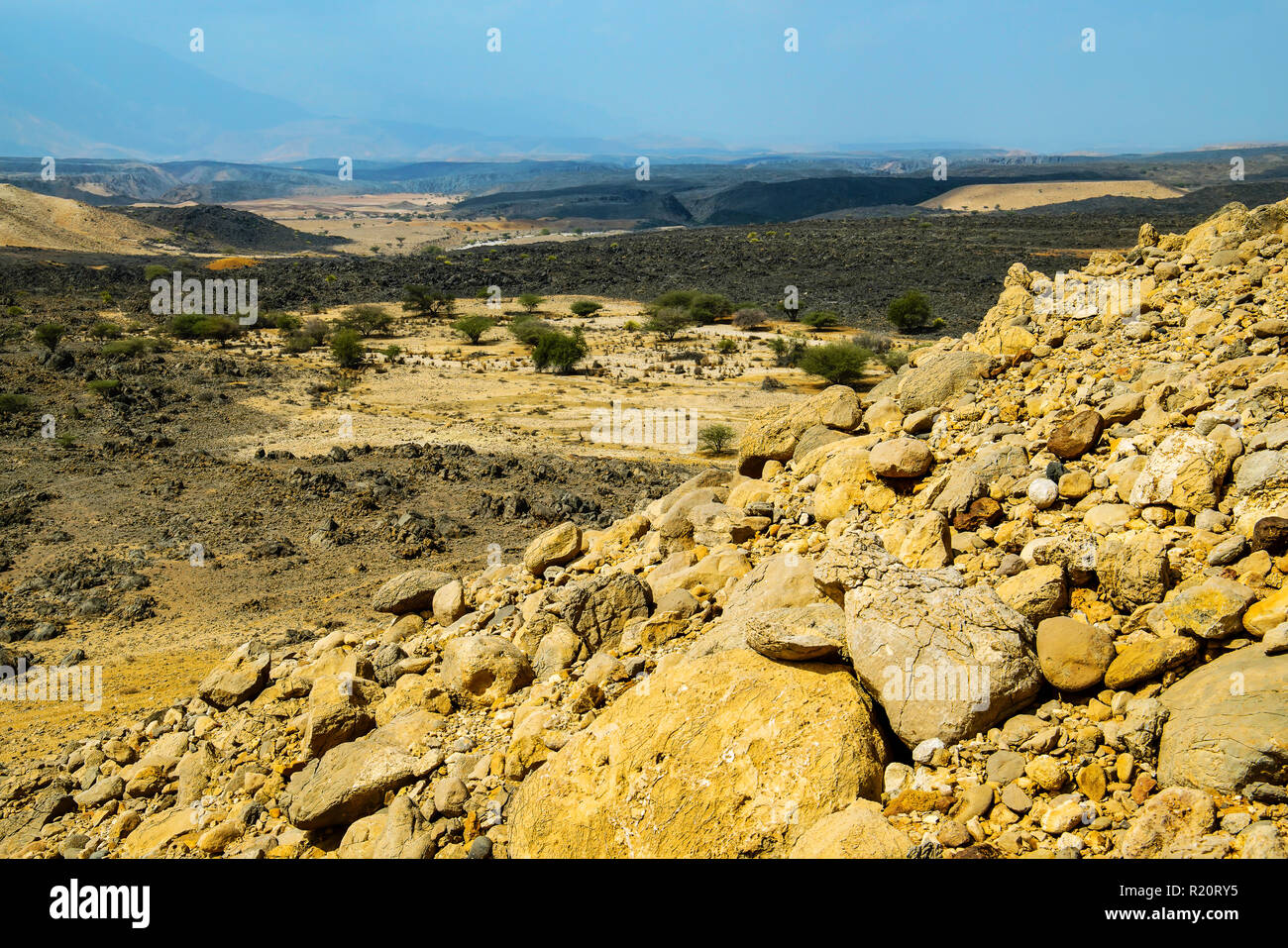 Lunar landscape around village Al Ya, Oman. - Stock Image